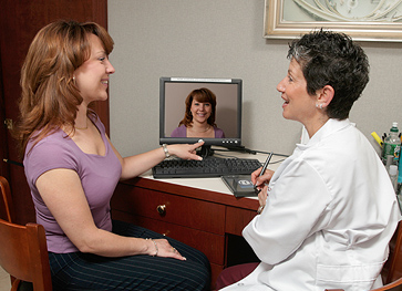 Patient and Provider looking at Computer Imaging