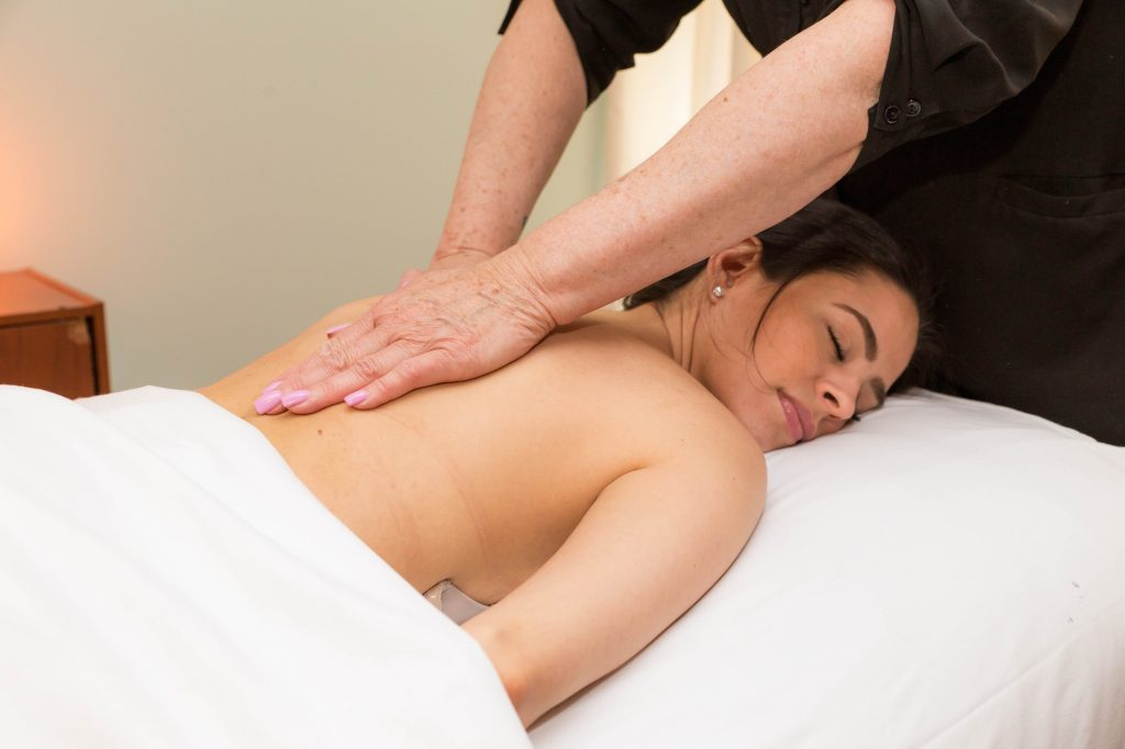 Woman lying face down getting a back massage