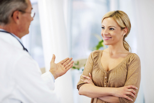 woman speaking with breast surgeon